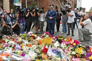 Flowers are laid at the site of the siege in Martin Place, Sydney in memory of those lost and in solidarity with the hostages. Photo credit: William West (AFP), via abc.net.au